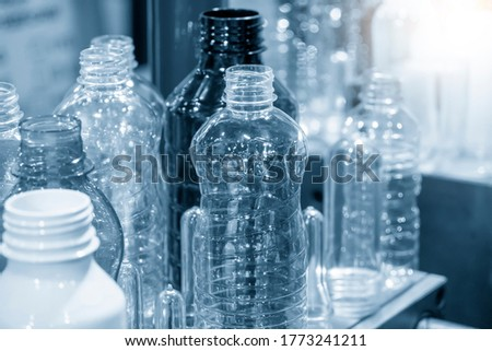 The PET bottles  sample collection  in the drinking water factory. The hi-technology of plastic bottle manufacturing process.