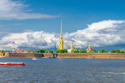 The Peter and Paul Fortress citadel, Saints Peter and Paul Cathedral Orthodox church with gold spire, fortress walls on Zayachy Hare Island, Neva river, Saint Petersburg Leningrad city, Russia