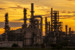 The petrochemical industry is in the morning yellow sunrise background.
