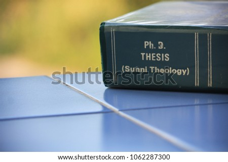 The Ph.D. thesis of Sunni Theology from the Faculty of Theology lay on the blue tile floor. #1062287300