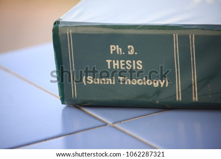 The Ph.D. thesis of Sunni Theology from the Faculty of Theology lay on the blue tile floor. #1062287321