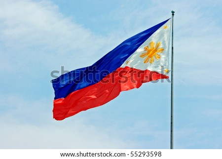 The Philippines flag waving in the blue sky