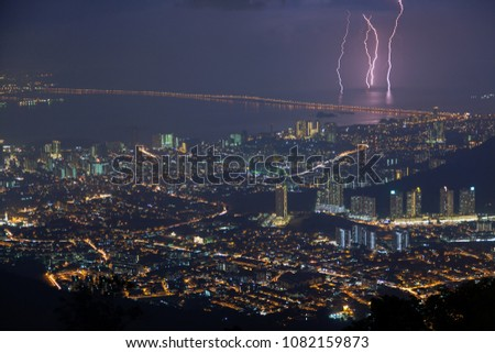 The photo combines 4 pictures taken during the 15 minute time-lapse shooting on Penang, it is interesting that the lightning strikes roughly the same and the same area covered with water