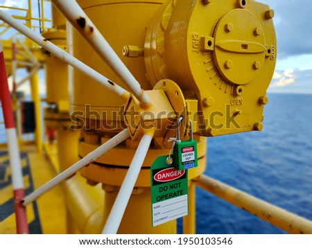 The photo is key lock with tag for isolated valve. Foto stock ©
