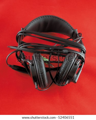 the  photo of a stereo headphones on red background
