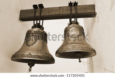 The photo of old orthodox copper church bells. Sepia.
