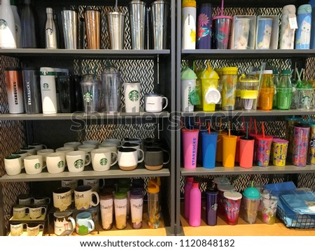 The photo of The colorful Starbuck mugs on their shelves in the Starbuck coffee shop Bangkok, Thailand April 12,2018 #1120848182