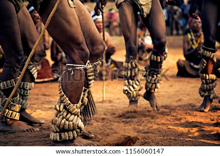 The photo was taken during the Kuru Dance Festival in Botswana, Africa, I group of men performing their traditional dance.