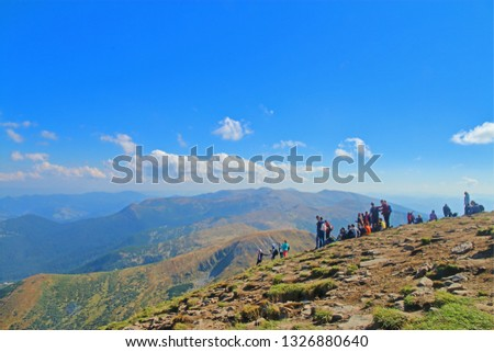 The photo was taken in Ukraine, in the mountains of the Carpathians. The picture shows a group of tourists on a halt in a mountain hike.