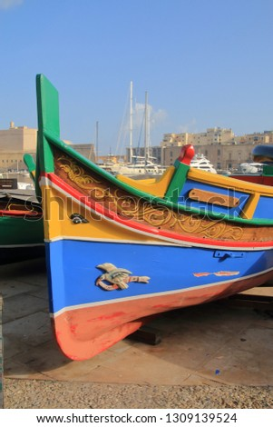 The photo was taken on the pier of the island of Malta. The picture shows the bright nose of a traditional Maltese boat.
