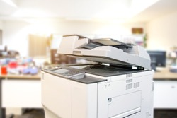 The photocopier or xerox printer machine is office work tool equipment in copy room for scanning document and printout a paper.