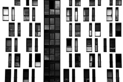 The photograph of a facade with symmetrically arranged windows/window facade