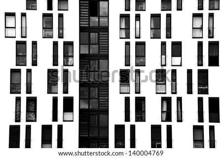 The photograph of a facade with symmetrically arranged windows/window facade