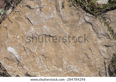 The photograph shows the stone surface with a divorce. #284784296