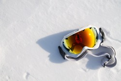 the photographer's reflection in snowboarder glasses