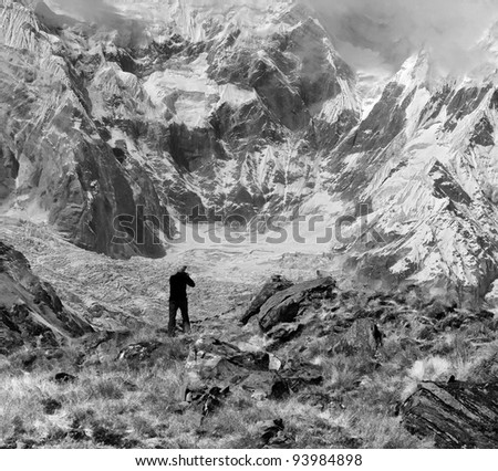 The photographer shooting Annapurnu from base camp (black and white) - Nepal