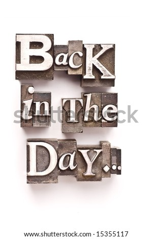 "The phrase ""Back in the Day..."" done in random letterpress type on a white paper background. - stock photo"
