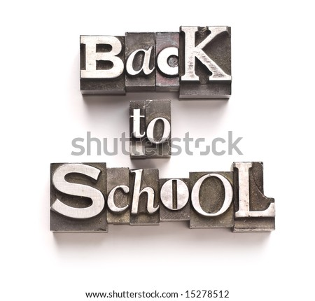 "The phrase ""Back To School"" done in random letterpress type on a white paper background."