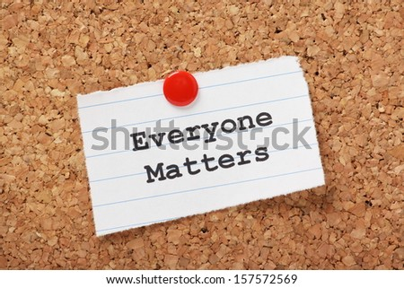 The phrase Everyone Matters typed onto a scrap of lined paper and pinned to a cork notice board