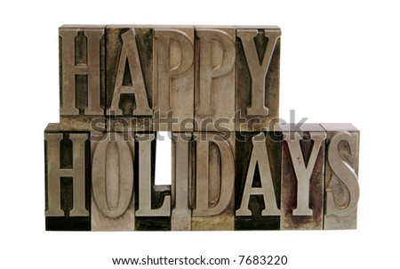 the phrase 'Happy Holidays' in letterpress metal letters isolated on white