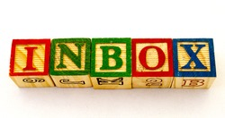 The phrase inbox visually displayed on a clear background using colorful wooden toy blocks image with copy space in horizontal format