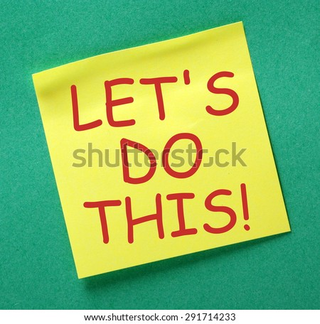 The phrase Let\'s Do This in red text on a yellow sticky note posted on a green notice board