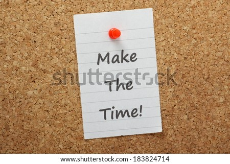 The phrase Make The Time typed on a piece of paper and pinned to a cork notice board. A concept for Time Management and getting your priorities in order