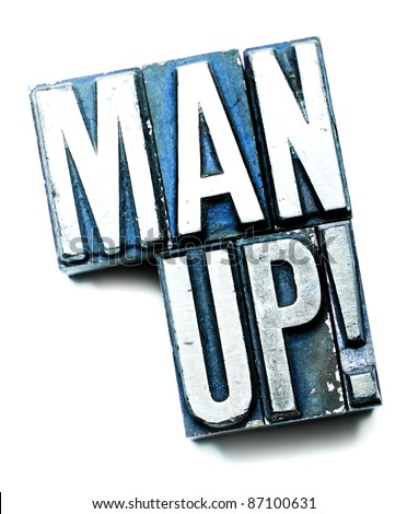 "The phrase ""Man Up!"" in letterpress type. Cross processed, narrow focus."