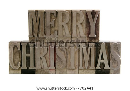 the phrase 'merry christmas' in letterpress metal letters isolated on white