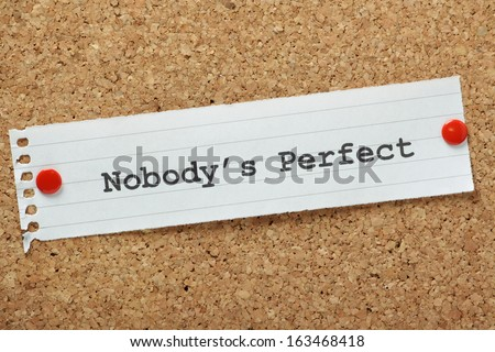 The phrase Nobody's Perfect typed on a piece of paper pinned to a cork notice board A concept for self improvement or acceptance that we all have flaws but this does not make us any less equal
