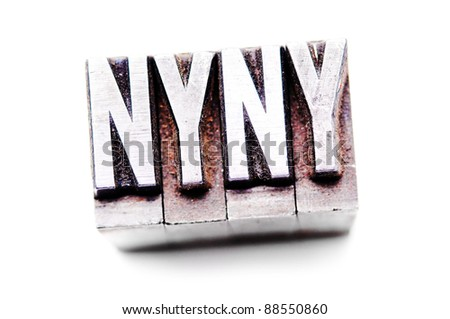 "The phrase ""NYNY"" in letterpress type. Cross processed, narrow focus."