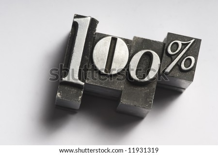 "The phrase ""100%"" photographed using old letterpress type. See my member portfolio for more vintage letterpress images."