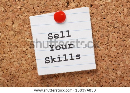 The phrase Sell Your Skills  typed onto a scrap of lined paper and pinned to a cork notice board. The ability to demonstrate out talents is essential for career success and your job search.
