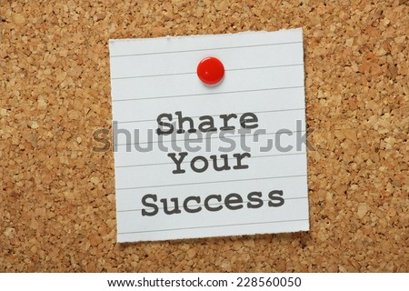 The phrase Share Your Success typed on a paper note and pinned to a cork notice board