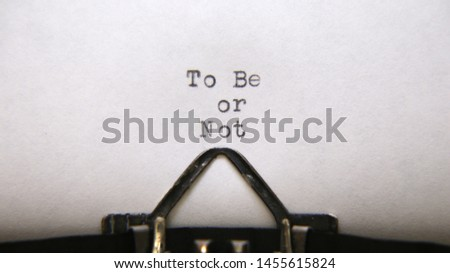 "The Phrase ""To Be Or Not"" Typed With A Vintage Typewriter Positioned Centered On Page"