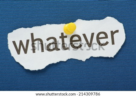 The phrase Whatever typed on a piece of torn paper and pinned to a blue notice board