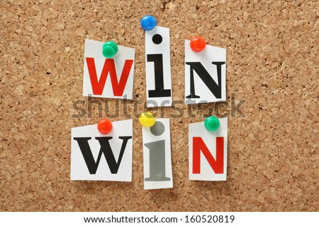 The phrase Win Win in cut out magazine letters pinned to a cork notice board. In any transaction or undertaking we look for mutual benefits and positive outcomes for all parties. #160520819