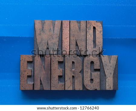 the phrase 'wind energy' on a blue paper background