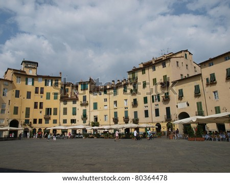 The Piazza Anfiteatro - Lucca , Italy. View from piazza Anfiteatro, former a Roman Ampitheatre, in Lucca. Tuscany, Italy.