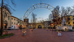 The Piazza Vittorio Emanuele II in the center of Bientina, Pisa, Tuscany, Italy, fully decked out with Christmas lights for the seasonal holidays, at dusk