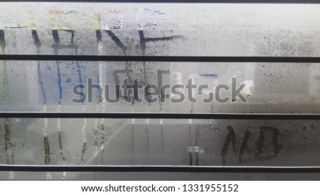 the pic is clicked during winters time.due to extreme cold the glass became little bit foggy and their are words written on it that is gods end here