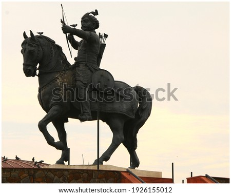 The picture depicts the statue of last Hindu ruler of Delhi, Prithviraj Chauhan based in the sunset of a Delhi evening.