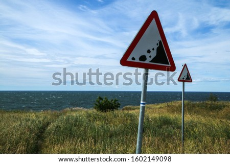 The Picture from the wild coast of Paldiski in Estonia. You can see the warning signs showing the instability of the cliffs.