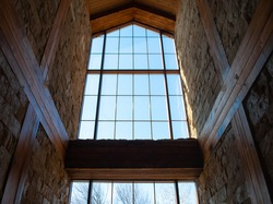 The picture of an old panoramic window in the castle. Huge window with wooden frame
