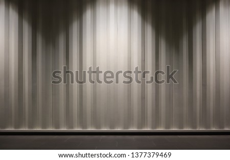 The picture of light beige container wall. Brightening by light bulb from the top. Backgrounf container wall picture. Copy space for editing #1377379469