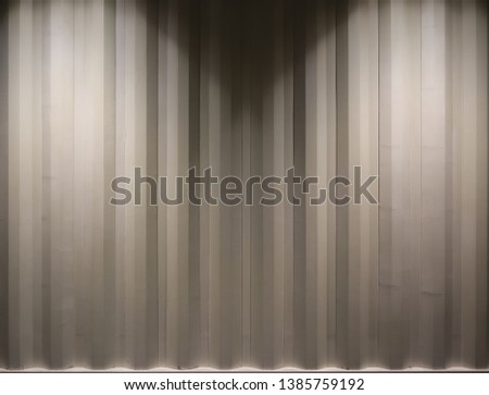 The picture of light beige container wall. Brightening by light bulb from the top. Backgrounf container wall picture. Copy space for editing #1385759192