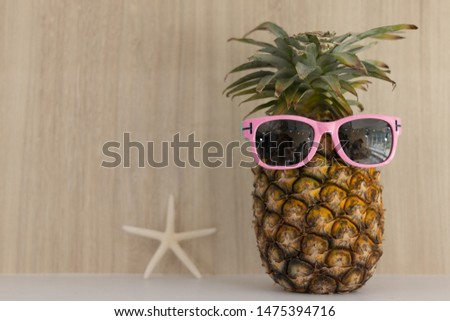 The picture placement the sea concept. Holiday travel Vacation Relaxation Power up. There are pineapple wear sunglasses and starfish. Wooden background