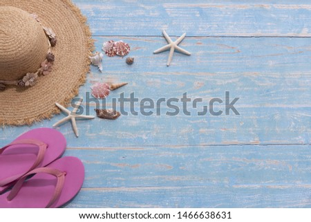The picture placement the Sea Vacation concept. Holiday Travel. There are hat for woman Shells Starfish and pink sandals. Blue wooden background. Vintage color