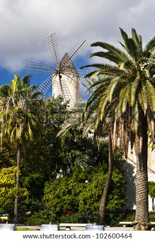 The picture shows a traditional windmill in Palma de Majorca, Spain.