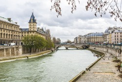 The picturesque embankments of the Seine in Paris, France. Buildings and trees.